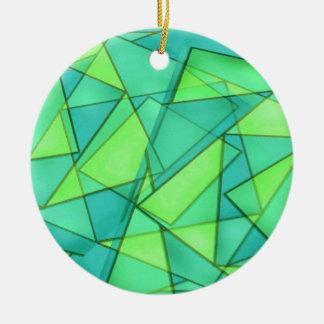 Triángulos de la turquesa y de la cal adorno redondo de cerámica