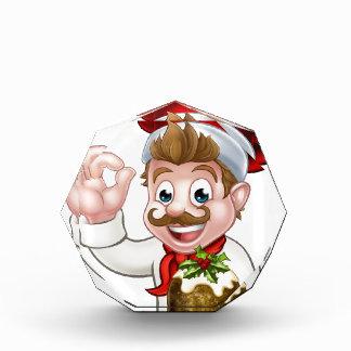 Trofeo Cocinero en el gorra del navidad que sostiene el