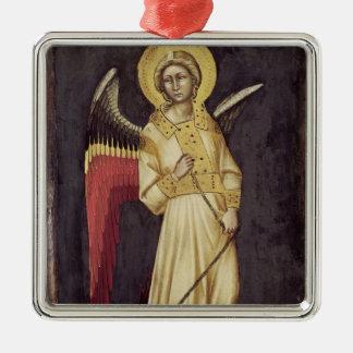 Un ángel con un demonio en una cadena adorno de reyes