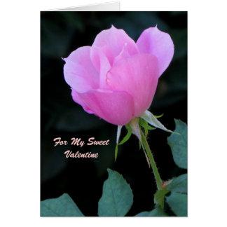 Un capullo de rosa rosado felicitación