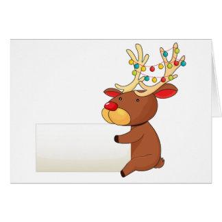 Un ciervo que sostiene un letrero vacío tarjeta de felicitación