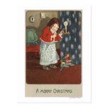 Un feliz ChristmasGirl que sostiene una palmatoria Postal