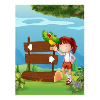 Un loro y un chica al lado de un letrero en la postal