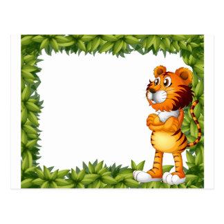 Un marco sonriente del tigre y de la planta postal