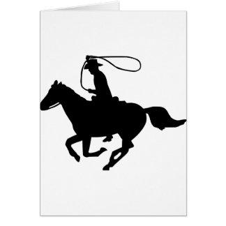 Un montar a caballo del vaquero con un lazo tarjeta de felicitación