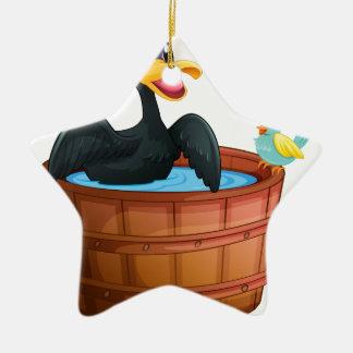 Un pato y un pájaro en la bañera adorno de cerámica en forma de estrella