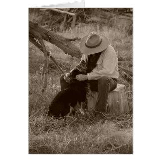 Un perro y su vaquero tarjeta de felicitación