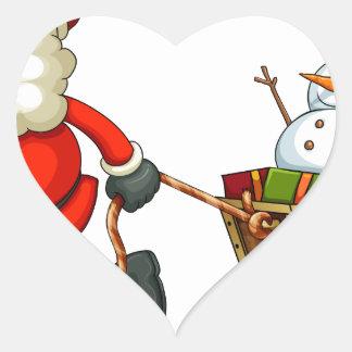Un Santa sonriente que tira de un trineo Pegatina En Forma De Corazón