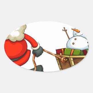 Un Santa sonriente que tira de un trineo Pegatina Ovalada