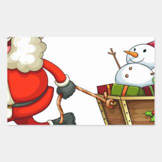 Un Santa sonriente que tira de un trineo Pegatina Rectangular