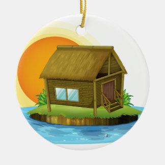 Una casa de bambú en la isla adorno de navidad