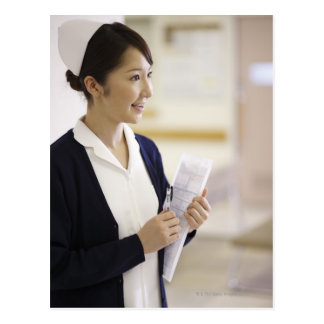 Una enfermera sonriente postal