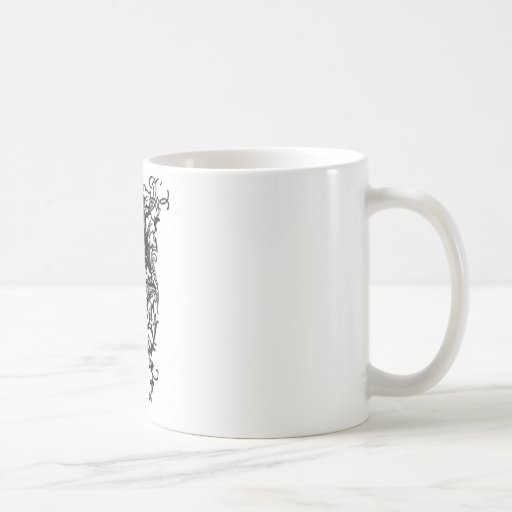 Una letra decorativa taza