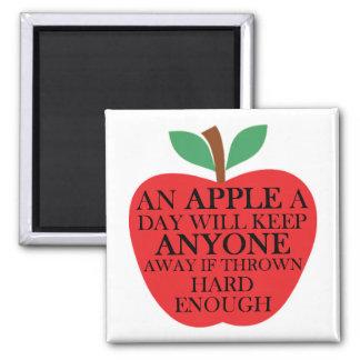 Una manzana un imán del cuadrado del día