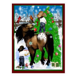 Una postal del navidad del caballo y del niño