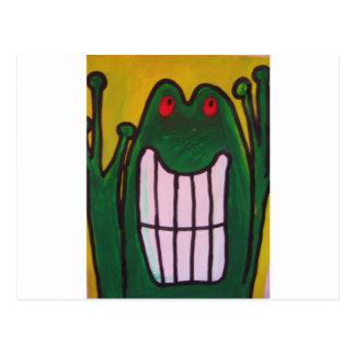 Una rana de risa le está mirando que la vida es postal