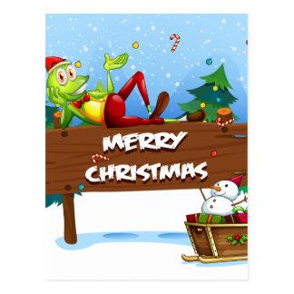 Una rana de Santa sobre el letrero del navidad Postal