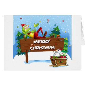 Una rana de Santa sobre el letrero del navidad Tarjeta De Felicitación