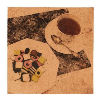 Una taza de postre del té y del caramelo de allsor posavasos