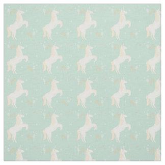 Unicornio en fondo de la menta con los elementos tela