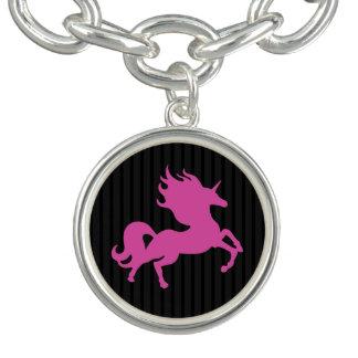 Unicornio rosado en el fondo negro (IPU) Pulseras