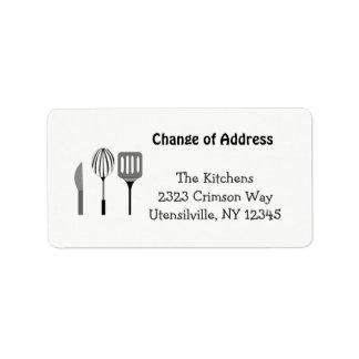 Utensilios para la nueva dirección de la cocina etiqueta de dirección