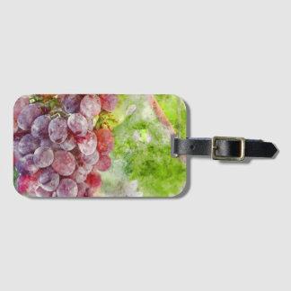 Uvas de vino rojo en vid etiqueta para maletas