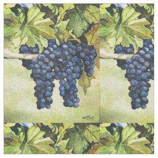 Uvas en la tela del arte de la vid