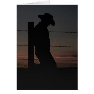 Vaquero en la puesta del sol tarjeta de felicitación