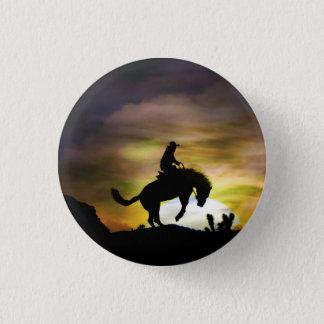 Vaquero y botón Bucking del caballo