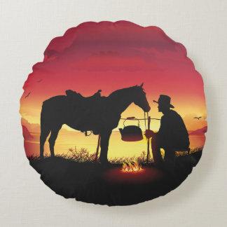 Vaquero y caballo en la almohada redonda de la cojín redondo