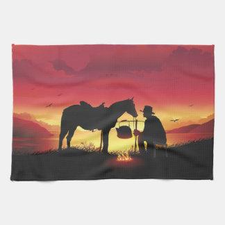 Vaquero y caballo en la toalla de cocina de la