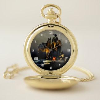 Vaqueros y reloj de bolsillo de los caballos