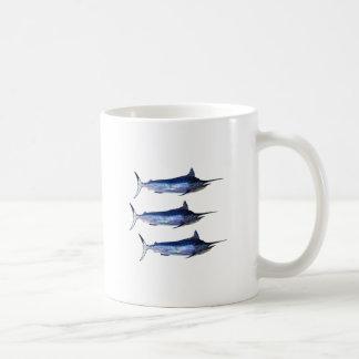 Vela lejos taza de café