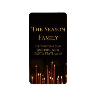 Velas ardientes de etiqueta del navidad