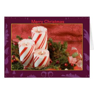 Velas rayadas del pilar del navidad tarjeta de felicitación