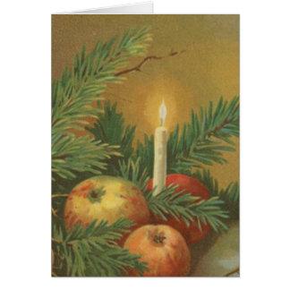 Velas y decoración del navidad tarjeta de felicitación