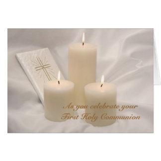 Velas y primera tarjeta de la comunión santa del l