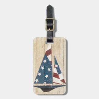 Velero con la bandera americana etiqueta para maletas