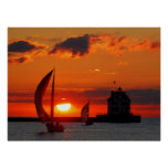 Veleros en la impresión de la puesta del sol
