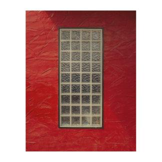 Ventana de cristal en una pared roja impresión en madera
