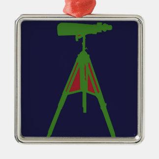 Verde con los prismáticos rojos en fondo de los adorno cuadrado plateado