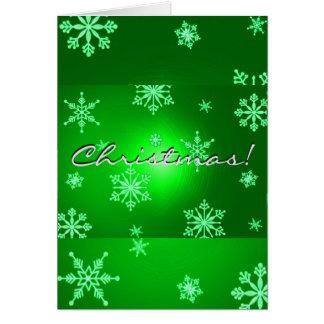 Verde de los copos de nieve del navidad en inglés felicitacion
