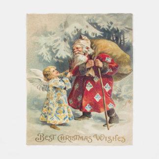 Victorian Santa con el ángel que entrega los Manta Polar