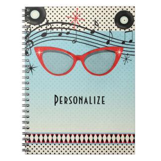 Vidrios rojos del ojo de gato del vintage de los cuaderno