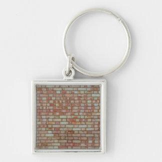 Vieja textura roja de la pared de ladrillo llavero cuadrado plateado
