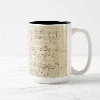 Viejas notas de la música - hoja de música de taza de café de dos colores