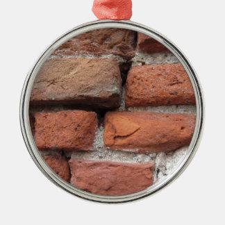 Viejo fondo de la pared de ladrillo adorno de cerámica