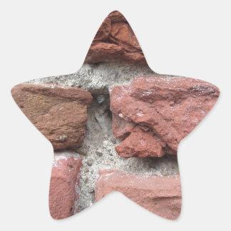Viejo fondo de la pared de ladrillo pegatina en forma de estrella