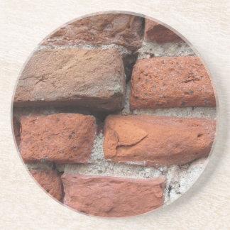 Viejo fondo de la pared de ladrillo posavasos